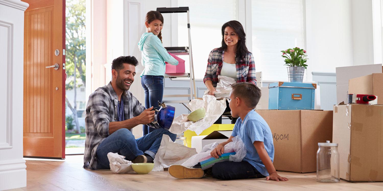 Hispanic-Family-Moving-Into-New-Home-000090649873_Double.jpg